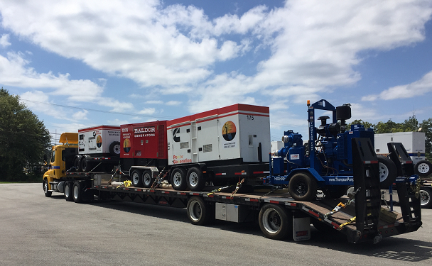 A truck carrying generators prepares to leave.