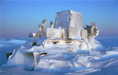 snow-covered-construction-equipment-bulldozer.png