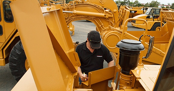 Inspecting-heavy-equipment-for-sale
